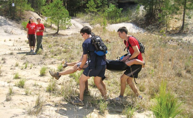 MedWar participants evacuate an injured hiker. Photo: Charity Pines