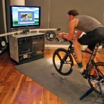 This custom indoor bike system, invented by Paul Krumrich, melds home-theater components witha a computerized resistance hub and bike-training software to allow a rider to become ensconced in a virtual experience.