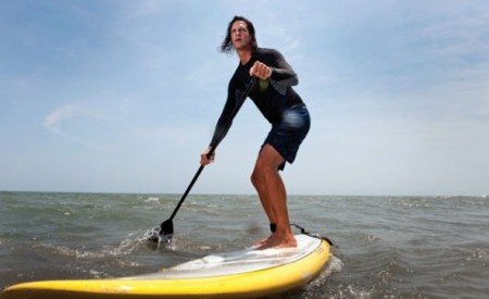 Buy a SUP, grow out your hair, and you could be this cool on the water.