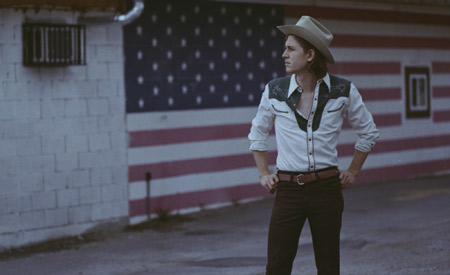 Cale Tyson doing country right, all the way down to the hat, shirt and flag.