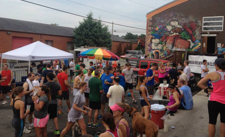 Runners and drinkers gather following a Wednesday night gathering at NoDa Brewing.