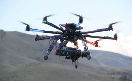 Drones, like this octocopter, are watching you play.