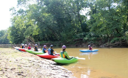 Anna Levesque leads a paddling clinic near Asheville, N.C.
