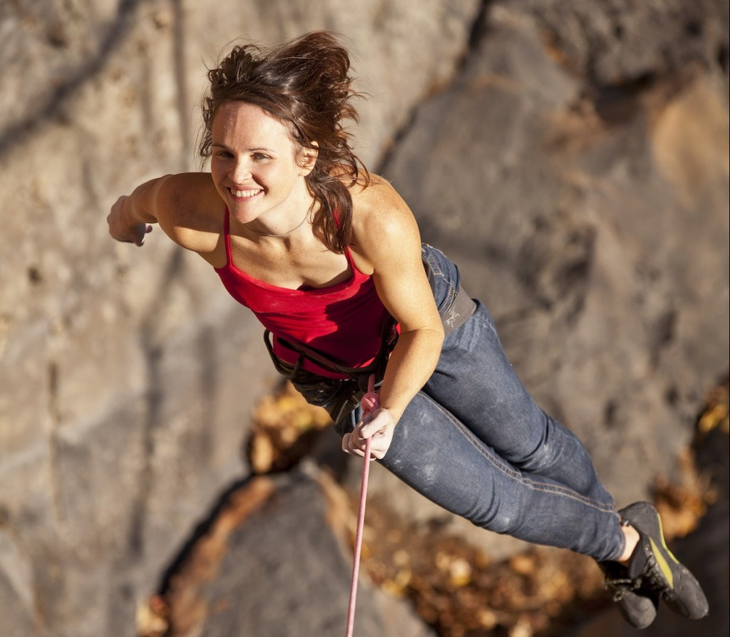 A woman is lowered off a rock climb in the New River Gorge, West Virginia.