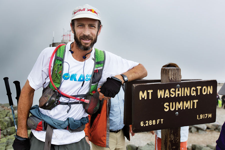 Karl Meltzer stops for a portrait at the summit of Mount Washington while attempting to break the record for fastest completion of the Appalachian Trail on Mount Washington in Gorham, New Hampshire on August 4, 2014 // Brian Nevins/Red Bull Content Pool // P-20140813-00236 // Usage for editorial use only // Please go to www.redbullcontentpool.com for further information. //