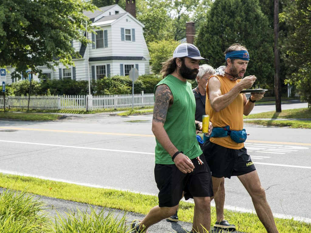 Karl Meltzer takes on some calories on the move, during his attempt to break the record for running the length of the Appalachian Trail on 13 August, 2016. / Red Bull Content Pool