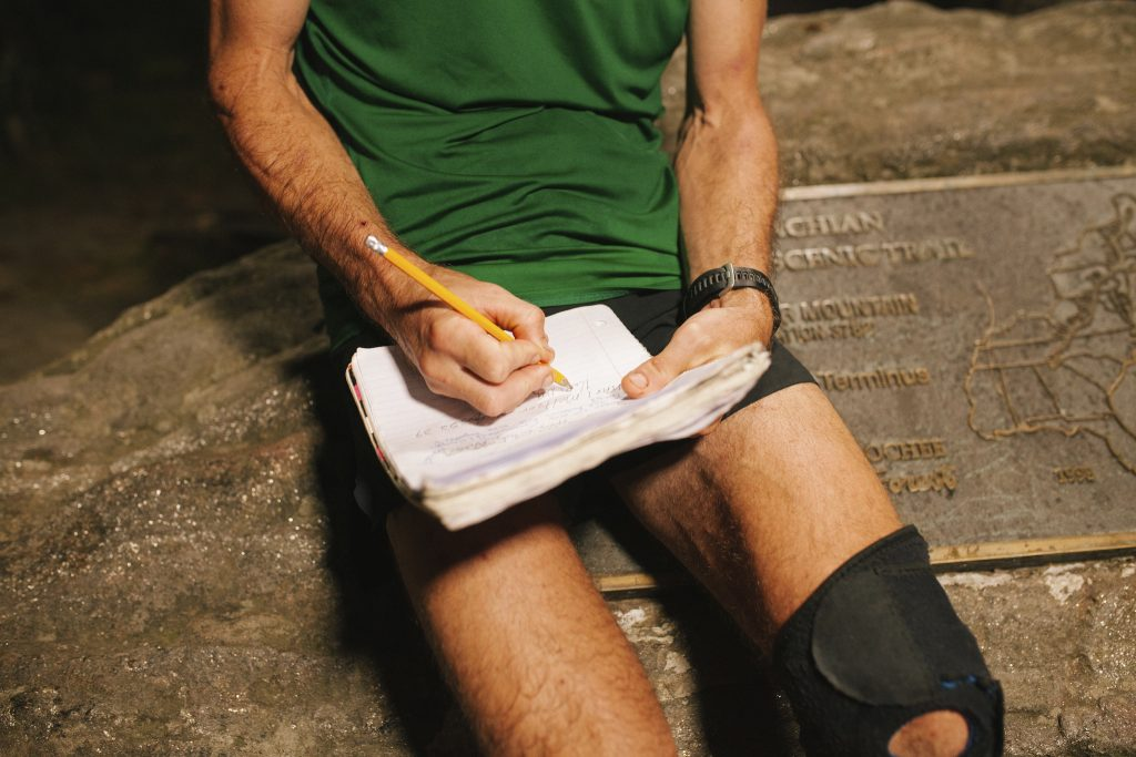 Karl Meltzer adds the last info to his logbook after breaking the record for running the length of the Appalachian Trail on 18 September, 2016.