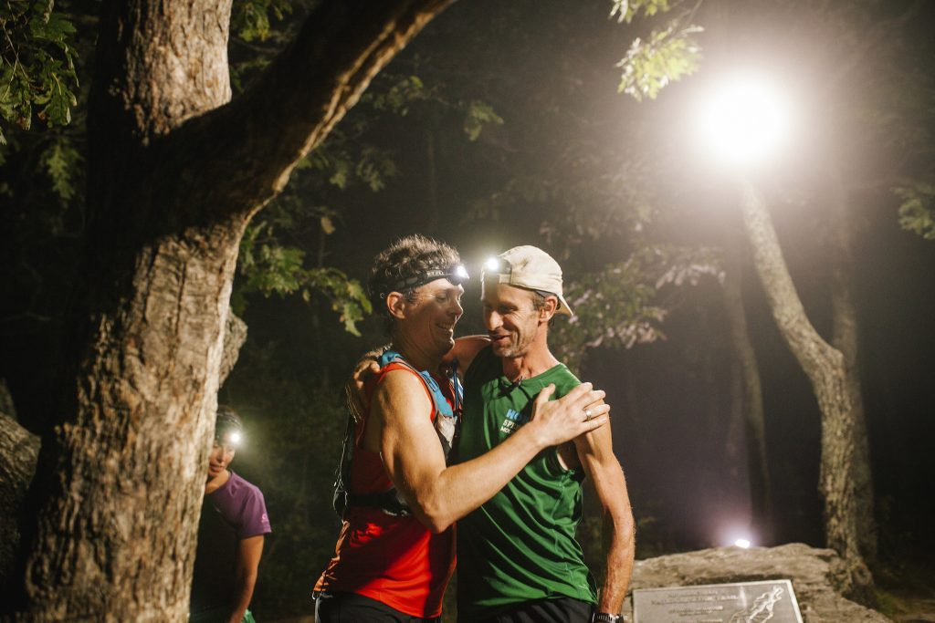 Karl Meltzer receives a hug from the previous record holder, Scott Jurek, after breaking the record for running the length of the Appalachian Trail on 18 September, 2016.