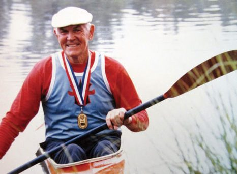 Frank Havens poses on the water for a story in Cooperative Living Magazine. / Photo by Priscilla Knight
