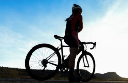 Female cyclist forced to stop and wait after catching up to male riders in a race
