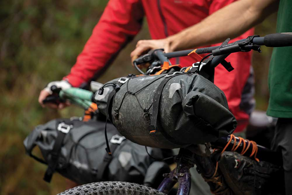 Bike Packers carry gear on their handlebars and in frame bags. / Photo by Jess Daddio