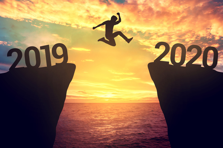 Businessman jump between 2019 and 2020 years.