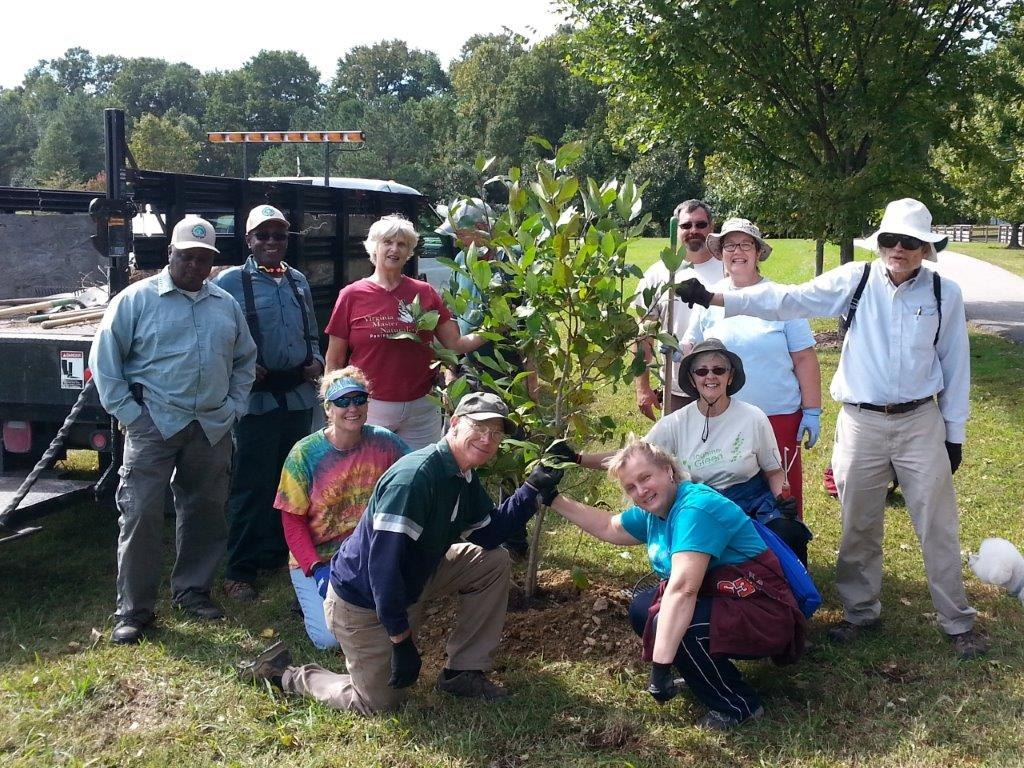A group of James River Association volunteers planting a tree