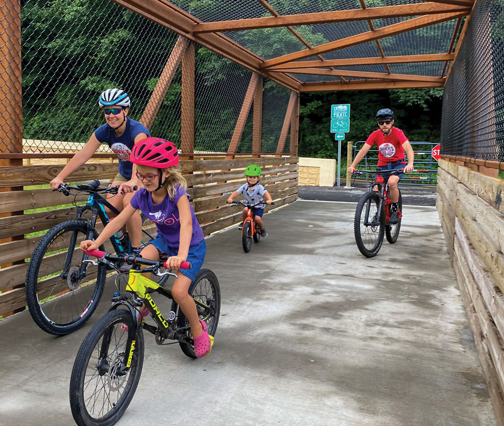 Family riding on the Allegheny Highlands Rail Trail